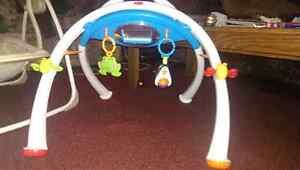 Baby fisher price lay under toy