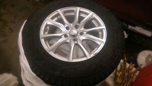 Reduced. Set of 2 Winter Tires on Alloy Rims With TPMS Sensors