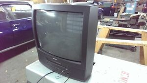 "21"" CRT TV and VCR combination."