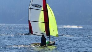 MX-Ray 11 foot sailing skiff with launching dolly.