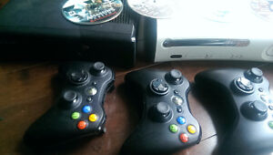 2 XBOX 360 (Black and Blacklisted White) Consoles