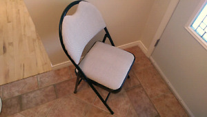 Eight folding chairs for sale.