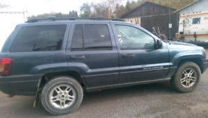 Jeep Grand Cherokee Laredo. Cash Only with xtra wheels/rims