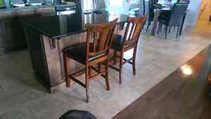 2 wood and leather bar stools