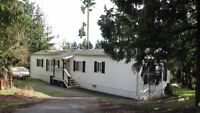 *1994 Mobile on large pad lot in Spectacle Lake Moblie Home Park