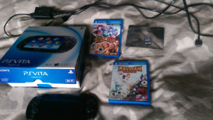 PS Vita (like new) with all original packaging, 3 games, and mem