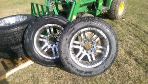 34 inch tires/ 20 inch moto metal 8 hole by 6.5