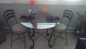 Wrought iron table and 4 chairs