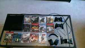 320 gig Ps3, 13 games,1controller, headset with mic and dock Cornwall Ontario image 1