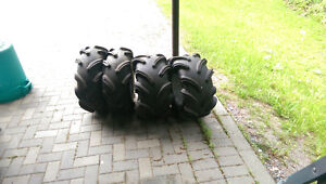 set of outlaw hight lift tires and rims