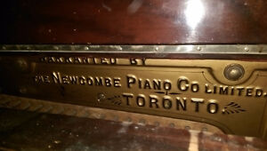 Free upright piano by Newcombe Piano Co.