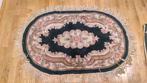 For sale set of two green  area rugs
