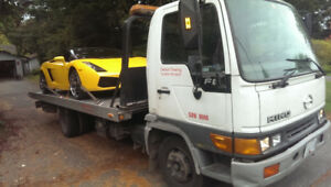 TOWING .TOW TRUCK .FLATBED
