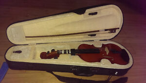 Child's Violin (1/8 size) with case,shoulder-rest, and bow.