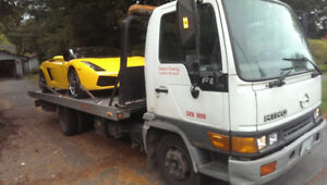 TOWING .FLATBED TOW TRUCK .    6047609537