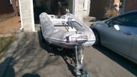 Duras 10 ft inflatable boat, trailer with Mariner outboard motor