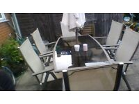 Glass Top Garden Dining Table and 6 Matching Chairs