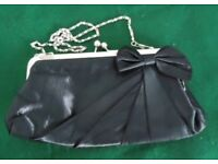 AS NEW BLACK FABRIC CLUTCH BAG.