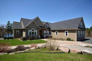 A TOUCH OF CLASS! Beautiful lakefront bungalow in Fall River!