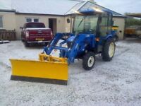 Garden Maintenance, landscaper compact tractor salting snow clearing