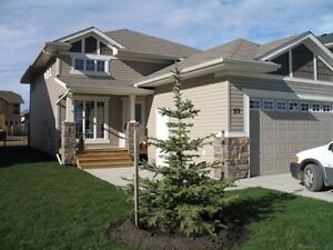 Vanier Woods Home with full basement suite!
