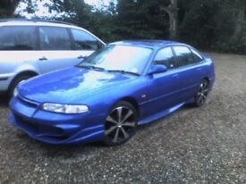 Mazda 626 unfinished project, KLZE imported engine, Vader body kit, reupholstered leather