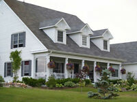 Southern Colonial House 4 for sale in Baddeck, NS, on 3 acres.