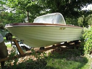 Need a fiberglass boat on steel trailer removed