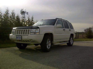 1998 5.9L Limited Jeep Grand Cherokee and Part.