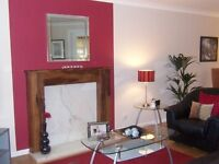 Open to offers. Contemporary wooden fire surround and marble hearth.