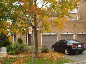 Bright & open concept end unit townhouse style condo for rent