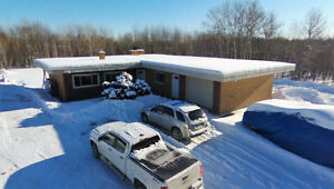Bungalow on 3 acres backing onto Timberwolf G.C.  (COMMERCIAL)