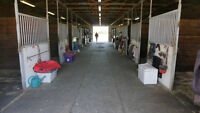 Horse training track with insulated building with 12 stalls.