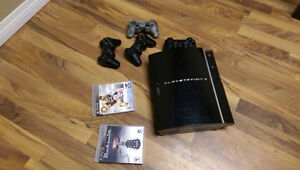 Sony Playstation 3 (PS3) with controllers and games