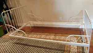 White metal frame for single bed