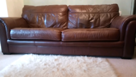 Large 4 seater real leather brown sofa