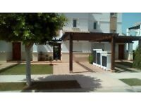 A 2 BEDROOM 2 BATHROOM VILLA OVERLOOKING POOL ON A LOVELY GOLF AND HOLIDAY RESORT IN MURCIA SPAIN.