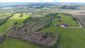 TOTALLY OFF THE GRID ON 141.20 ACRES!!