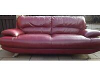 Red leather 3 seater and 2 seater sofas. With high back support and chrome legs.