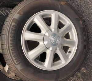 Set of 4 Buick Allure rims with 225 60 16 inch tires