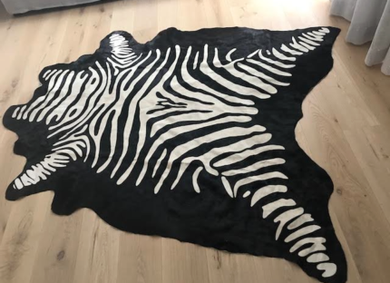 GENUINE BLACK AND WHITE COW HIDE RUG