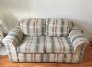 A classy/fancy style love seat Couch