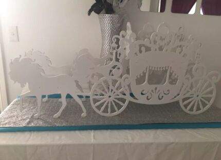 Large white horse and carriage stand