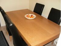 Solid Oak 6 seater dining table and 6 brown leather chairs