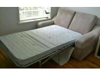 1 year old beige fabric and leather sofa bed