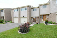 Spacious 4 bedroom condo! With a garage & private backyard!