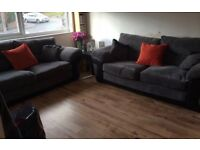 Two charcoal Grey three seater sofas for sale