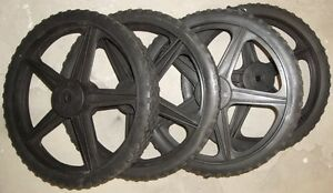 "4 - 13 1/2"" PLASTIC WHEELS X 1 3/4"" WIDE WITH 1/2"" AXLE HOLE"