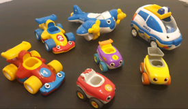 7 toy vehicles Plane Police Car 2 Racing Cars (all friction) & 3 small