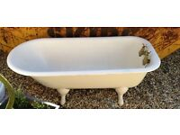 Cast iron roll top bath with taps and claw feet